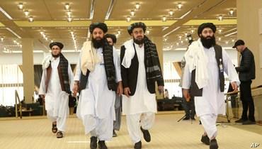 """وفد من """"طالبان"""" يستعد للتوقيع على الاتفاق مع الولايات المتحدة، 29 شباط 2020 - """"أ ب"""""""