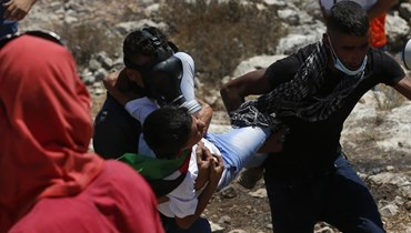 فلسطيني مصاب خلال المواجهات في بيتا