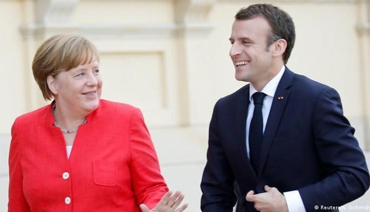 الرئيس الفرنسي ايمانويل ماكرون والمستشارة الالمانية انجيلا ميركل