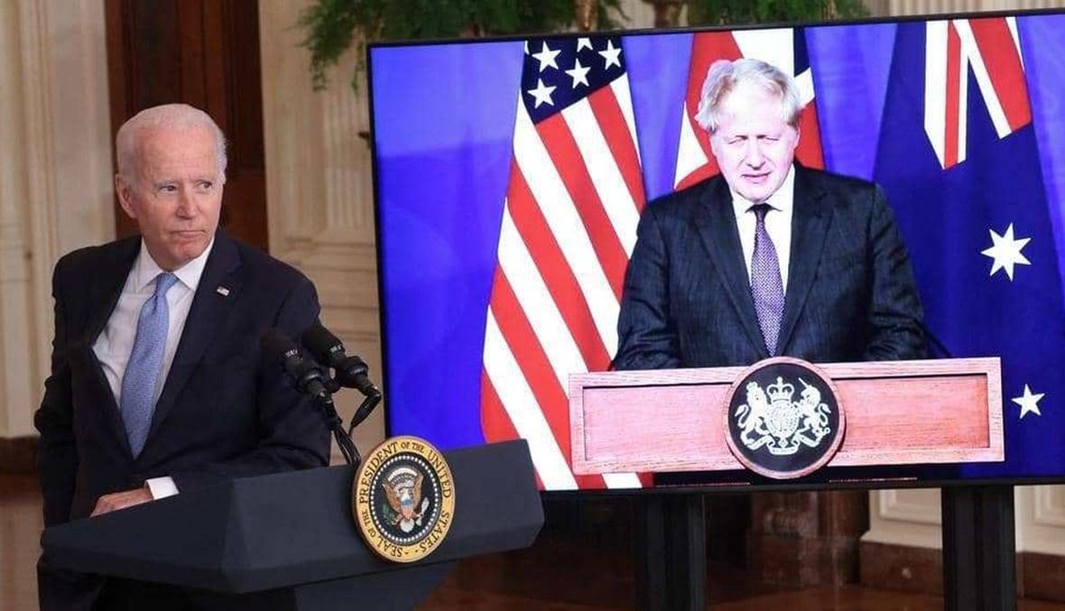 جو بايدن خلال المحادثات عبر الفيديو مع رئيسي وزراء أستراليا وبريطانيا