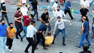 من مشاهد قمع السلطة الفلسطينية للمحتجين