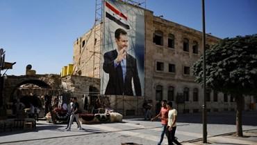 صورة للرئيس السوري وسط دمشق. أ ف ب