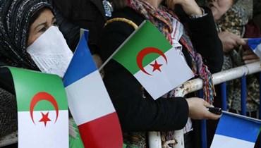 أعلام جزائرية وفرنسية