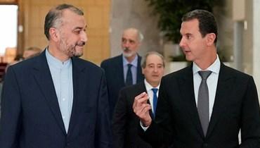 الأسد مستقبلاً عبداللهيان في دمشق