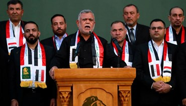 زعيم تحالف الفتح هادي العامري يتحدث خلال تجمع انتخابي في بغداد  في 5 أكتوبر 2021. أ ف ب
