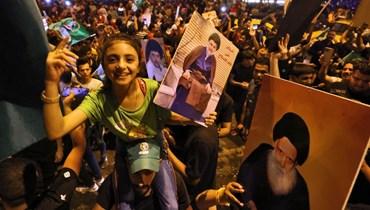 احتفال أنصار الصدر في ساحة التحرير ببغداد في 11 أكتوبر. أ ف ب