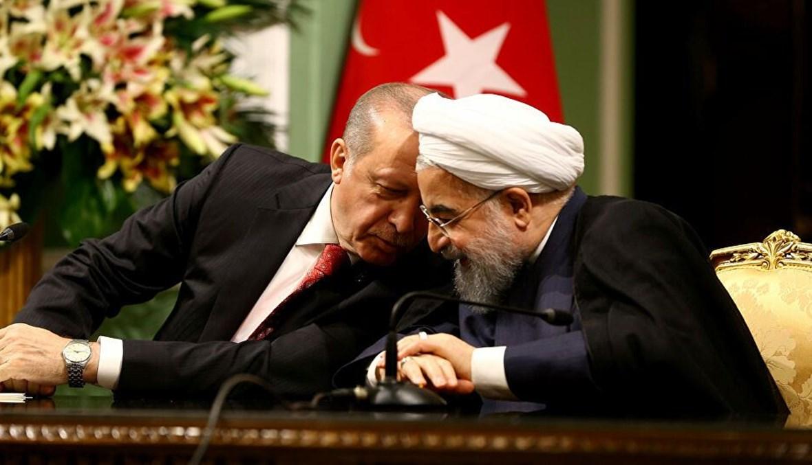 الرئيس الايراني حسن روحاني ونظيره التركي رجب طيب اردوغان